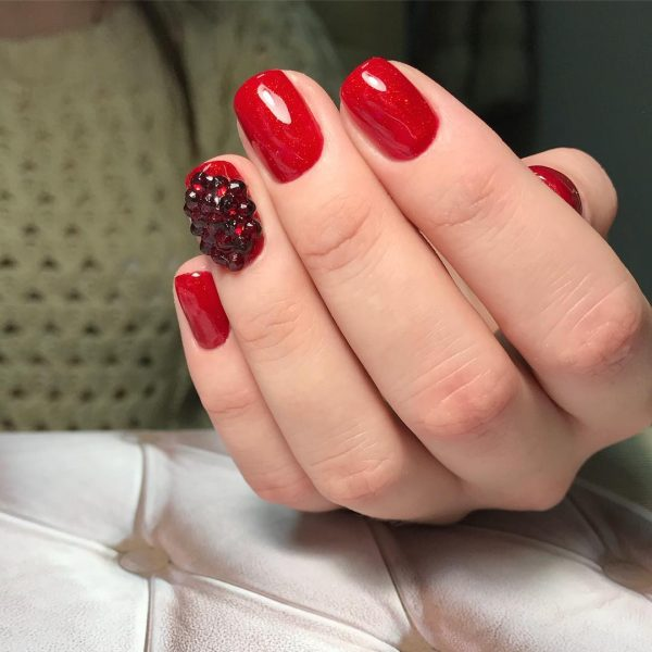 Credit Red Nails And An Accent Nail With Amazing Black Rhinestones