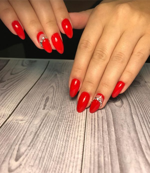 Credit Red Nails And An Accent Nail With Beautiful Rhinestones