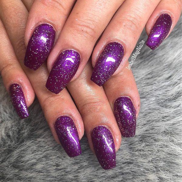 Beautiful glitter purple coffin nails!