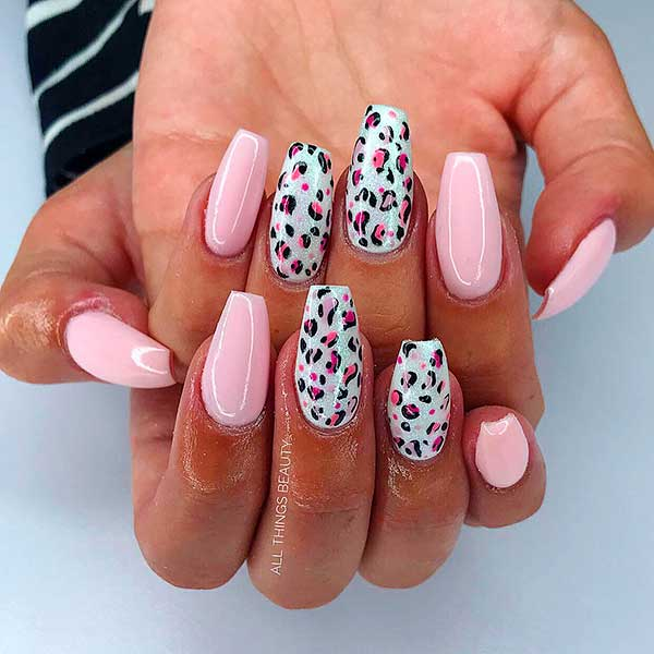 Chrome baby pink coffin nails with two leopard print nails!