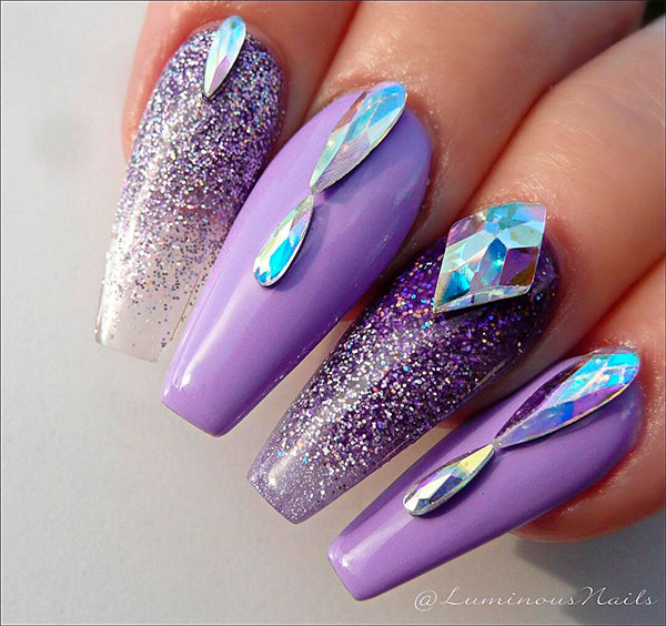 Adorable light purple coffin nails design with crystals and glitter