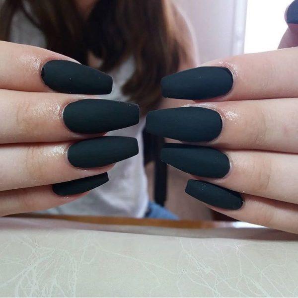 Amazing matte black ballerina nails.