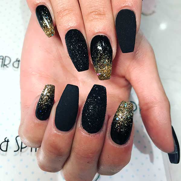 Cute black and gold glitter nails!