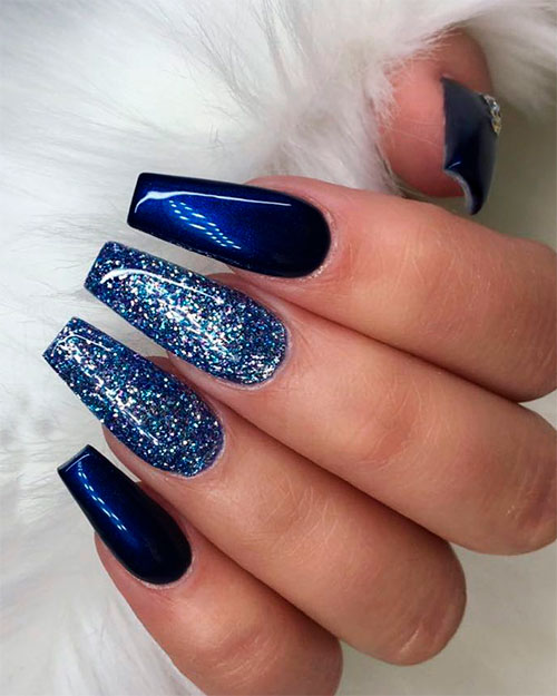 Cute navy blue coffin nails with glitter!
