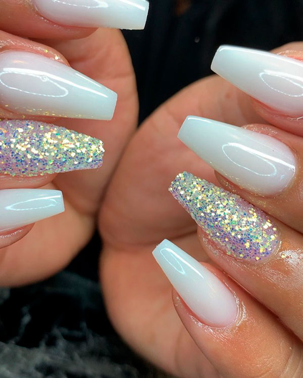 Cute white coffin nails with an accent glitter nail