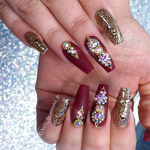 Gorgeous burgundy coffin nails with golden glitter and rhinestones!