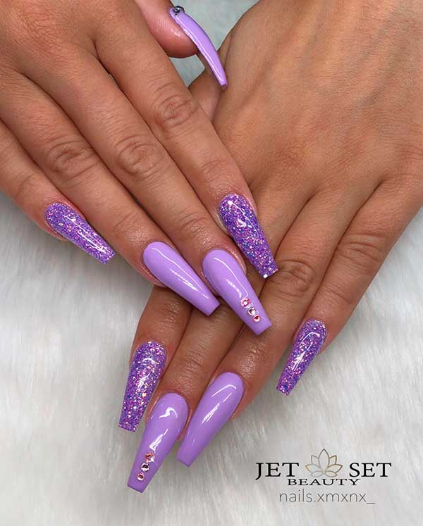 Gorgeous light purple coffin nails set with glitter and rhinestones!