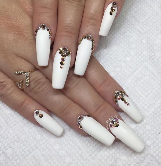 Gorgeous matte white coffin nails with rhinestones