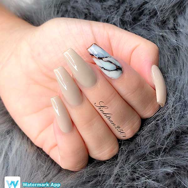 Pretty coffin shaped nude nails set with an accent marble nail!