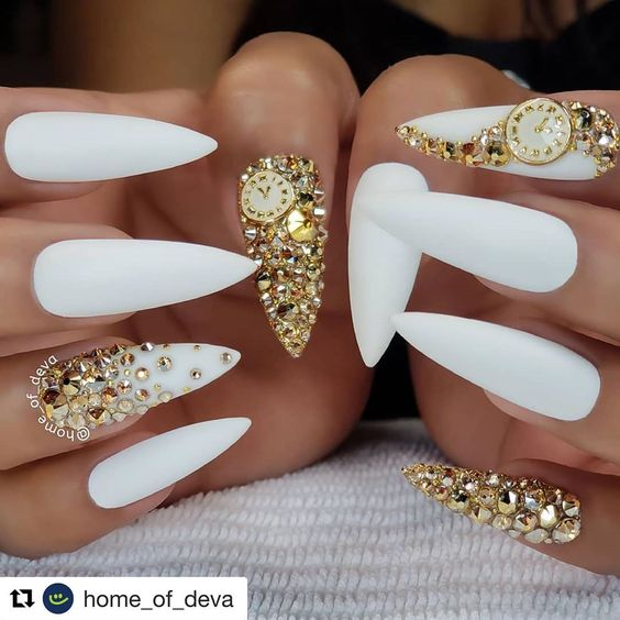 Gorgeous winter white new year's nails with gold rhinestones!