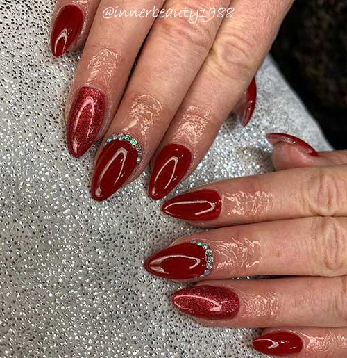 red almond shaped valentine's day nails 2020 with glitter red accent nail and rhinestones