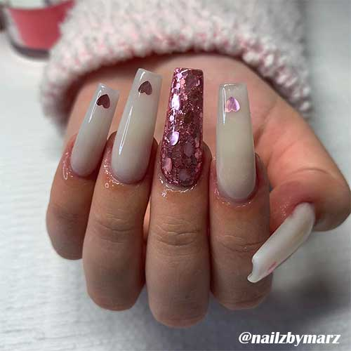 Cute valentines day nails with glitter hearts!