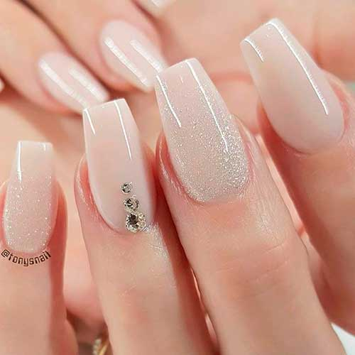 Cute nude nails with glitter and rhinestones design!