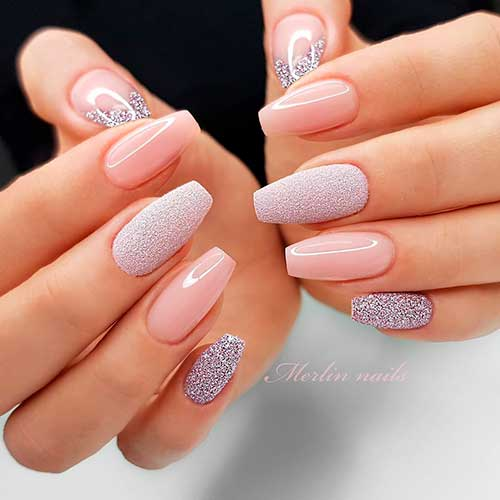 Gorgeous coffin shaped nude nails with glitter accent nails design!