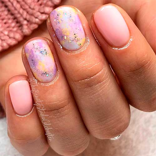 Cute pastel pink spring short nails 2020 with two accent pastel multicolor acrylic nails with glitter