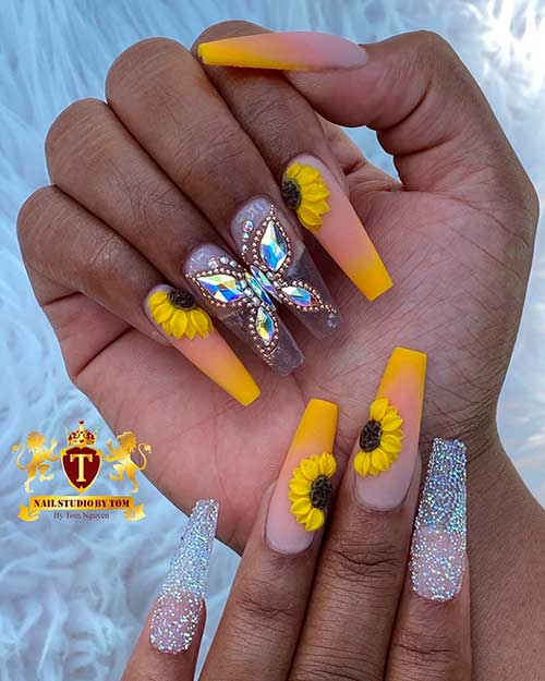 Cute coffin shaped summer yellow ombre nails 2020 with sunflower nails, two rhinestoned butterfly nails and two glitter nails design!